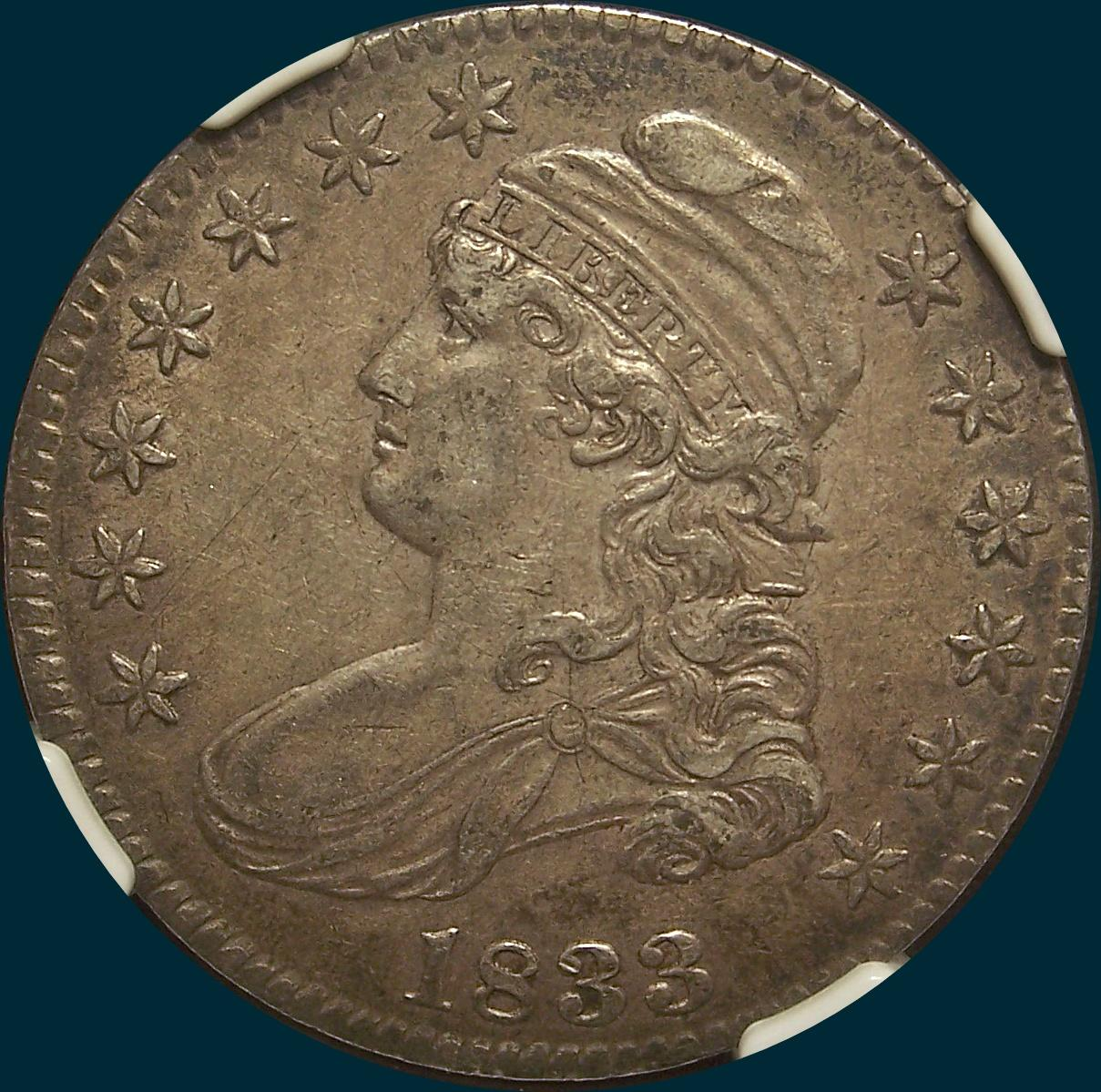 1833 O-113, capped bust half dollar