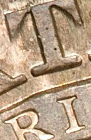 i shade right of center of t 1827 capped bust half dollar