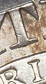 I centered under right side of stem of t 1827 capped bust half dollar
